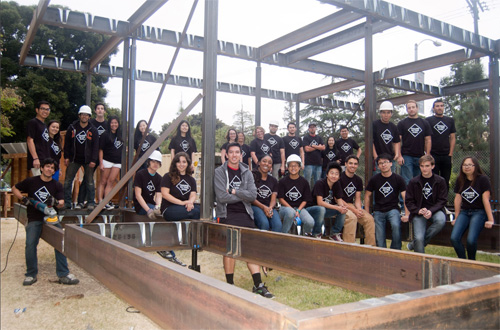 Team USC's poses with their entry for the 2013 Solar Decathlon